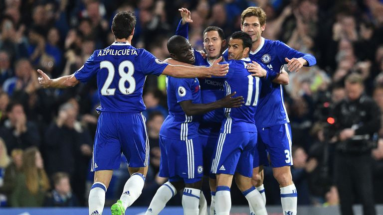 Hazard is mobbed by team-mates after scoring Chelsea's opening goal against Manchester City