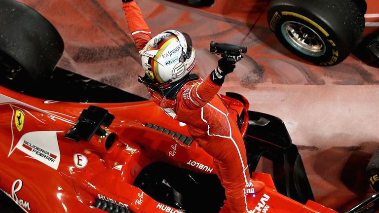 Image result for Vettel beats penalised Hamilton to victory