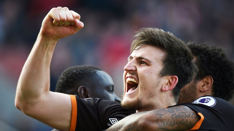 Harry Maguire celebrates his equaliser against Stoke City