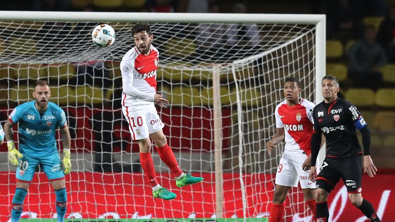 Bernardo Silva (C) goes for a header during Monaco's 2-1 win against Dijon