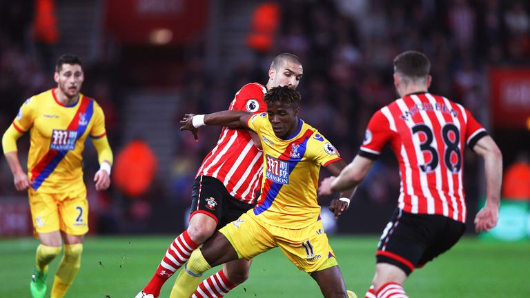 Oriol Romeu and Wilfried Zaha battle for possession at St Mary's