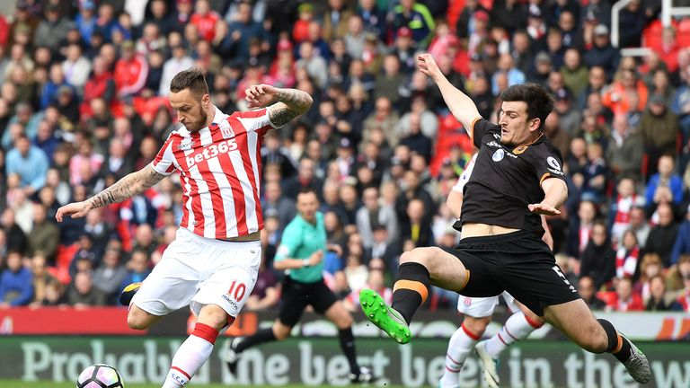 Marko Arnautovic scores for Stoke City as Harry Maguire attempts to block his shot