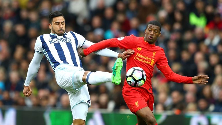 Nacer Chadli and Georginio Wijnaldum of Liverpool battle for possession