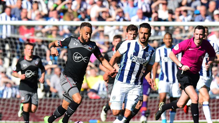 Nathan Redmond takes the ball past Nacer Chadli as Southampton claimed victory away from home