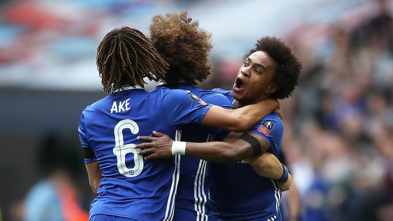 Willian celebrates with team-mates after restoring Chelsea's lead at Wembley