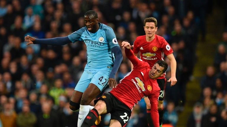 Yaya Toure (left) rides the challenge of Henrikh Mkhitaryan