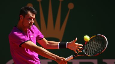 Bernard Tomic is through to face Andy Murray at the Barcelona Open after beating Dustin Brown