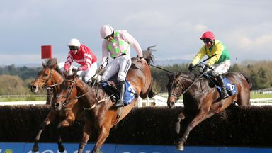 Jockey Robbie Power on board Sizing John (right) goes on to win the Coral Punchestown Gold Cup