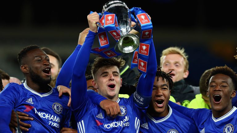 LONDON, ENGLAND - APRIL 26:  Mason Mount of Chelsea lifts the trophy as Chelsea celebrate victory in the FA Youth Cup Final, second leg between Chelsea and