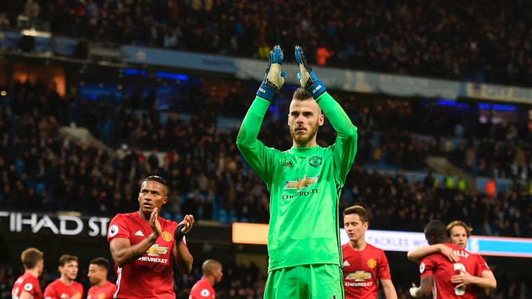 Manchester United's Spanish goalkeeper David de Gea (C) applauds their fans at the end of the English Premier League football match between Manchester City