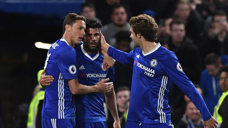 Chelsea's Brazilian-born Spanish striker Diego Costa celebrates with Chelsea's Serbian midfielder Nemanja Matic (L) and Chelsea's Spanish defender Marcos A