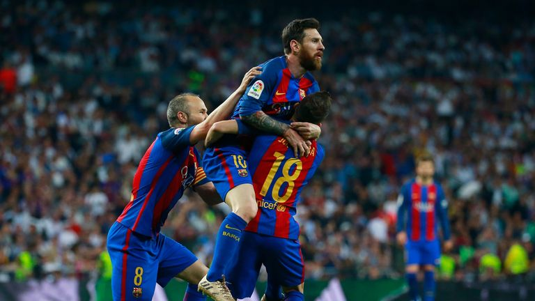 MADRID, SPAIN - APRIL 23:  Lionel Messi of Barcelona (C) celebrates as he scores their first and equalising goal with team mates during the La Liga match b