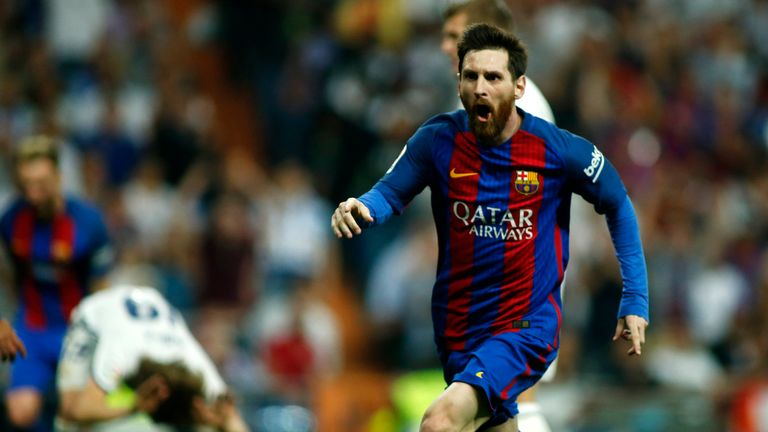 Barcelona's Argentinian forward Lionel Messi celebrates Barcelona's third goal during the Spanish league football match Real Madrid CF vs FC Barcelona at t