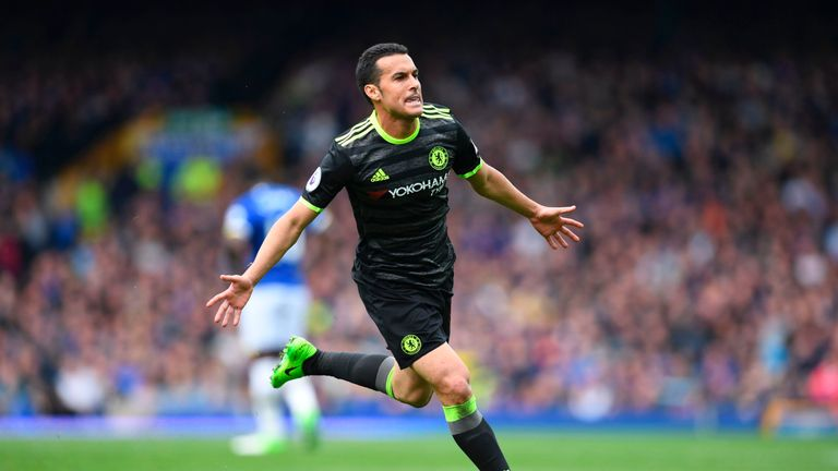 Chelsea's Spanish midfielder Pedro celebrates scoring the opening goal during the English Premier League football match between Everton and Chelsea