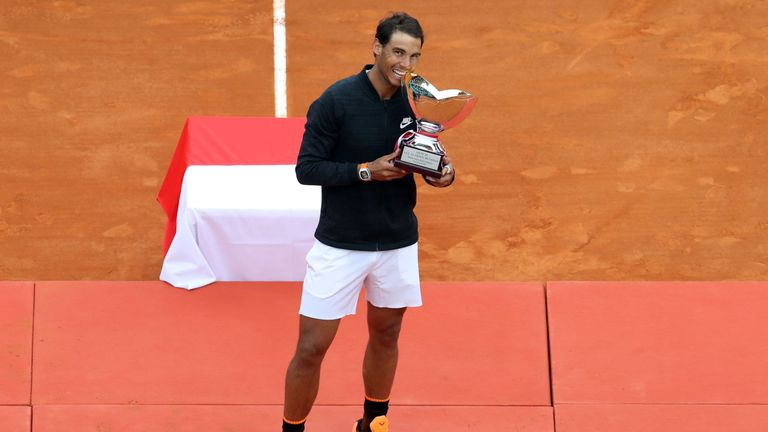 Spain's Rafael Nadal celebrates and bites the trophy during the prize ceremony after winning the Monte-Carlo ATP Masters Series Tournament final tennis mat