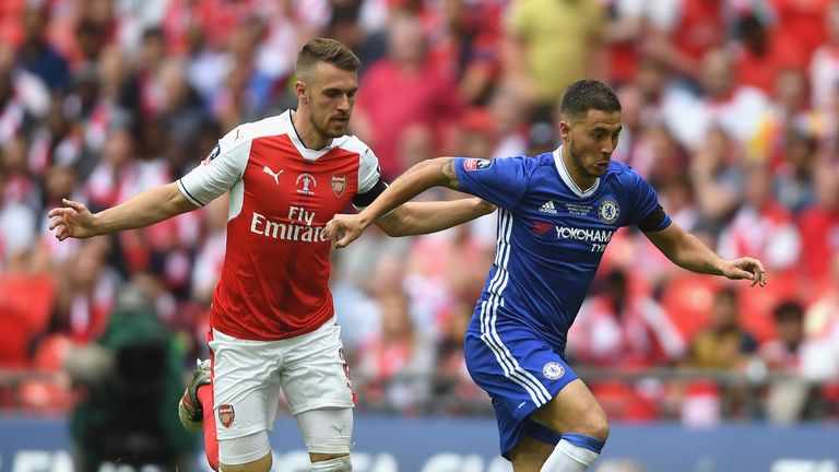 Eden Hazard of Chelsea is chased down by Aaron Ramsey
