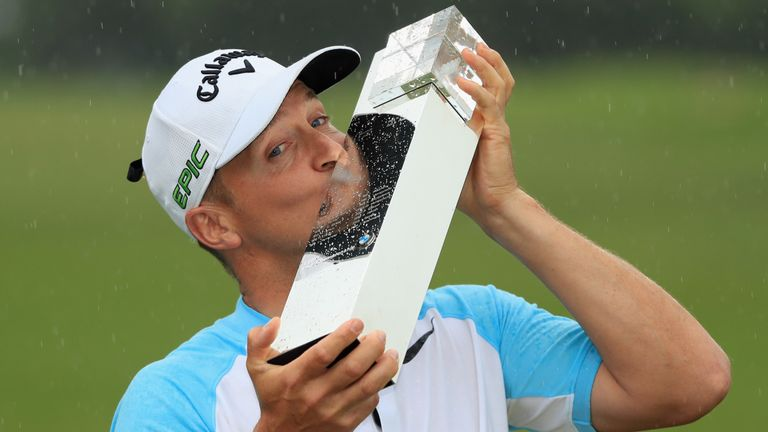 Noren poses with the trophy after his BMW PGA Championship success