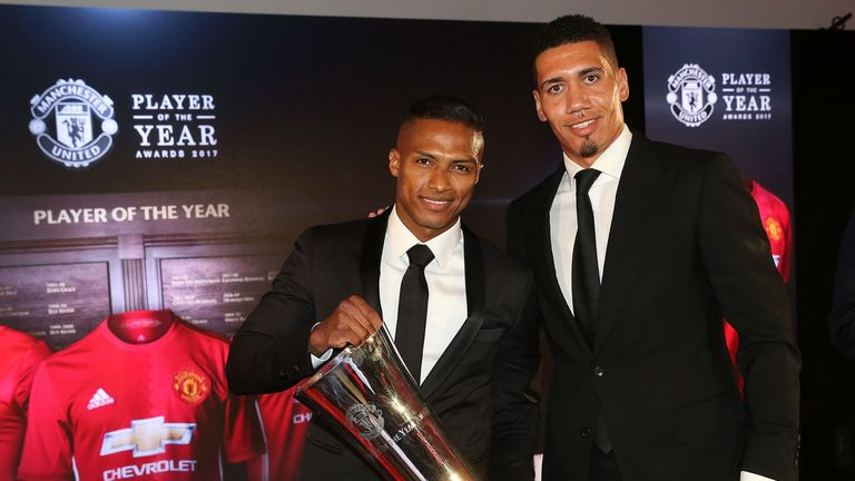Antonio Valencia is presented with the Players' Player of the Year award by last year's winner Chris Smalling