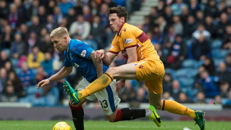 Ben Heneghan, a reported transfer target for Rangers, tackles Martyn Waghorn at Ibrox earlier this season