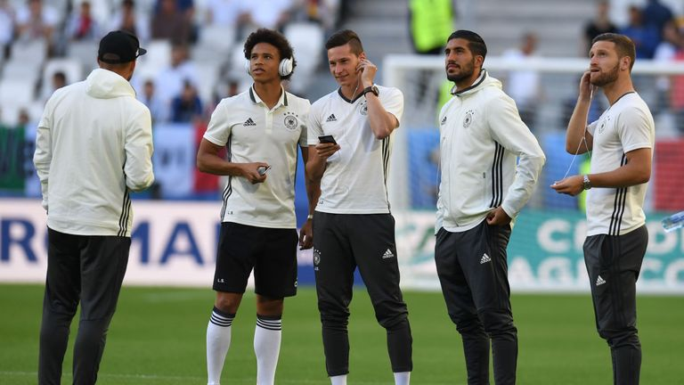 Emre Can (left) and Shkodran Mustafi have all been included in Germany's squad