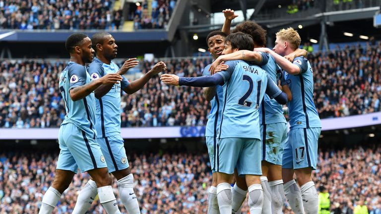 David Silva celebrates scoring the opening goal against Leicester with his Man City team-mates