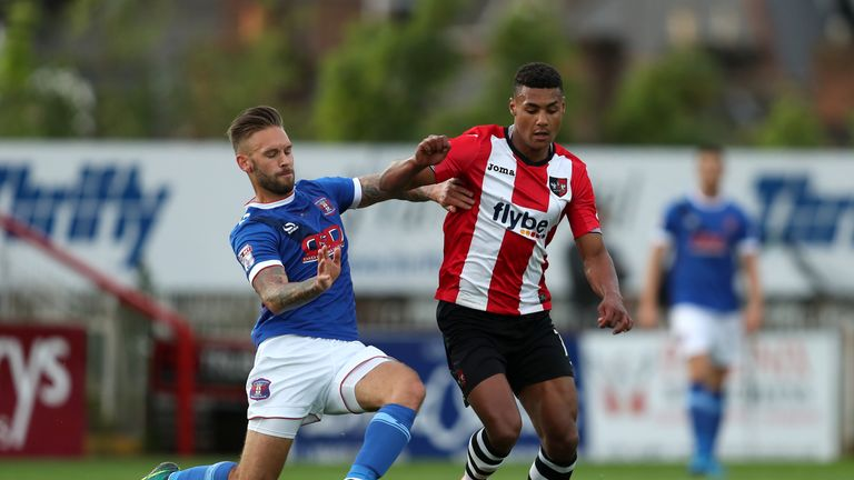 Exeter City's Ollie Watkins (right) is also a target for Brentford