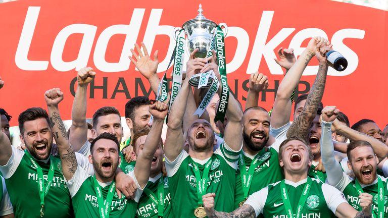 Hibernian celebrate with the Ladbrokes Championship trophy