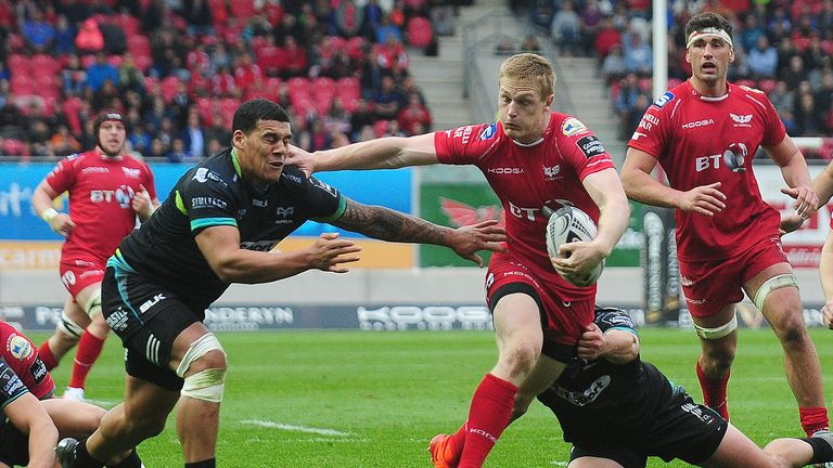 Johnny McNicholl evades the tackle of Josh Matavesi as the Scarlets cruised past the Ospreys in the final round of the regular season