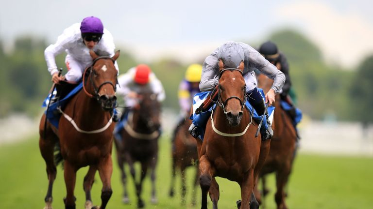 Main Desire ridden by Daniel Tudhope (right) wins the Langleys Solicitors British EBF Marygate Fillies' Stakes