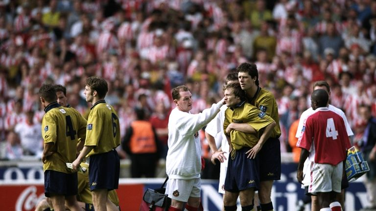 Michael Gray is consoled by Sunderland team-mate Niall Quinn