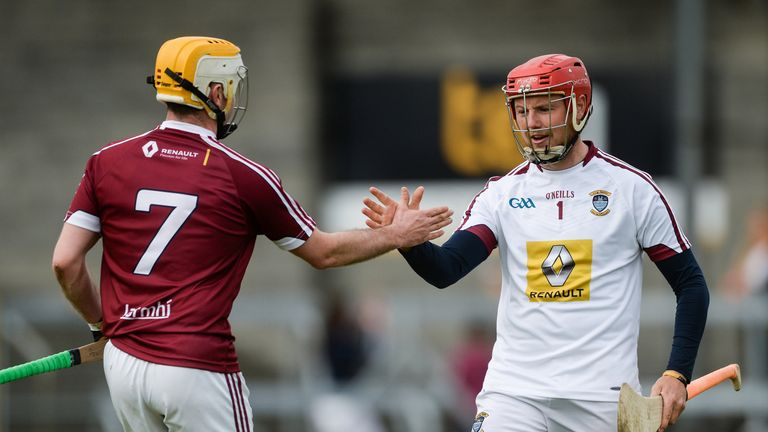 Westmeath's Paddy Maloney (R) and Shane Power (L) celebrate after their historic win over their neighbours in Mullingar