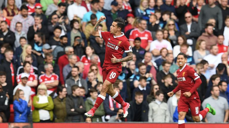 Liverpool's Brazilian midfielder Philippe Coutinho celebrates scoring his team's second goal