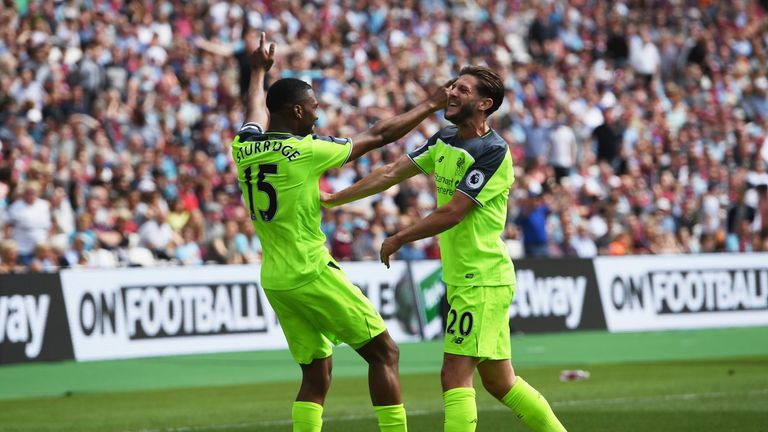 Daniel Sturridge of Liverpool celebrates scoring his side's first goal with Adam Lallana during the Premier League match at West Ham