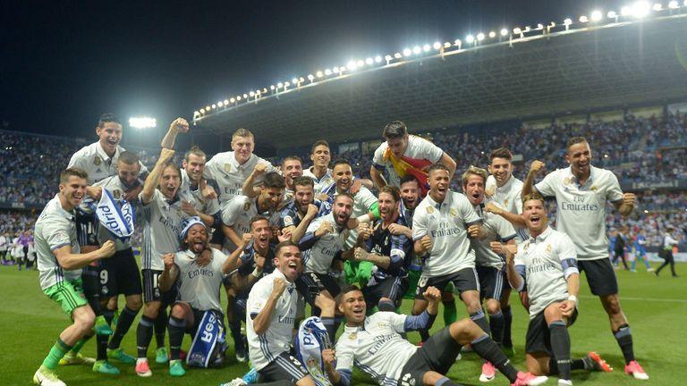The Real Madrid squad celebrate winning the La Liga title