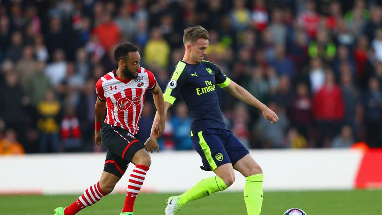 Nathan Redmond of Southampton closes down Rob Holding of Arsenal