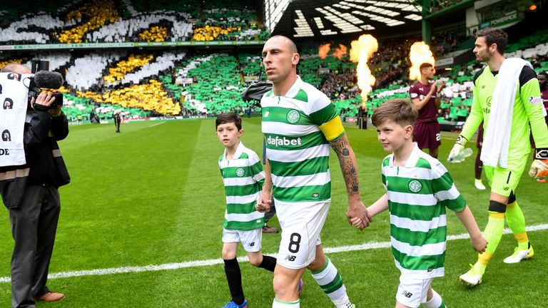 Celtic captain Scott Brown leads out the side