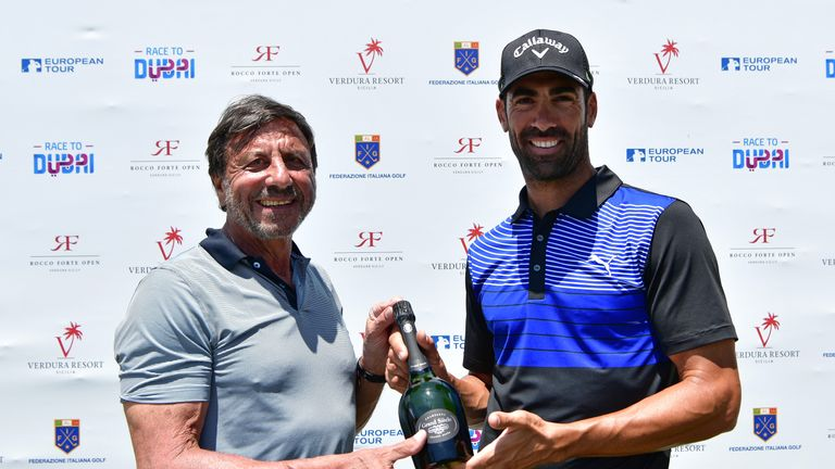 Sir Rocco Forte presented Alvaro Quiros with a bottle of champagne after his ace