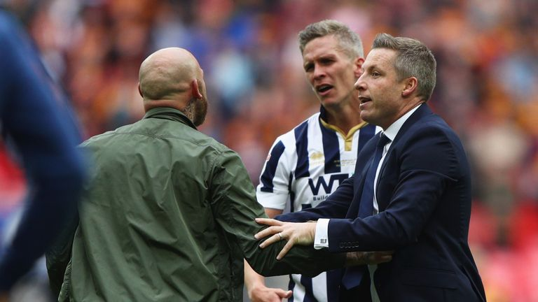 Match-winner Steve Morison and manager Neil Harris usher supporters off the pitch at Wembley