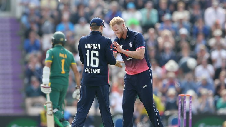 Ben Stokes celebrates with Eoin Morgan after taking the wicket of South Africa's Hashim Amla