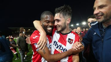 Exeter City's Jordan Moore-Taylor (right) and Joel Grant celebrate after the final whistle