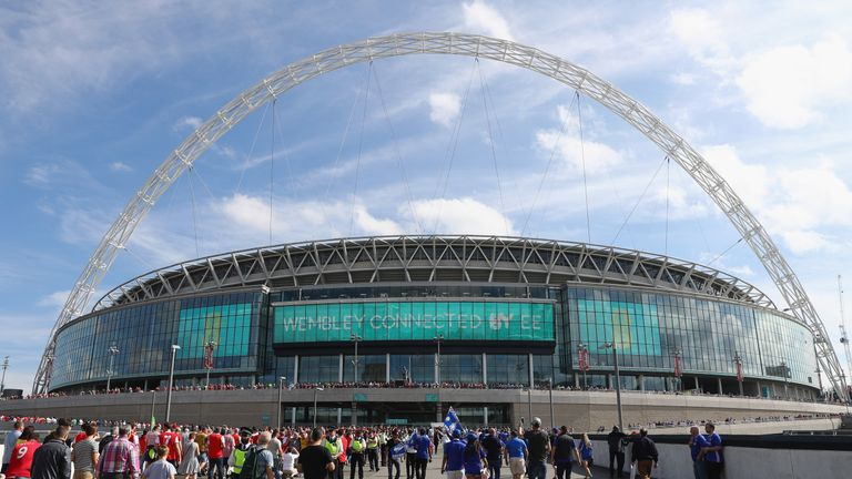 LONDON, ENGLAND - MAY 27:  Fans arrive at the stadium prior to The Emirates FA Cup Final between Arsenal and Chelsea at Wembley Stadium on May 27, 2017 in