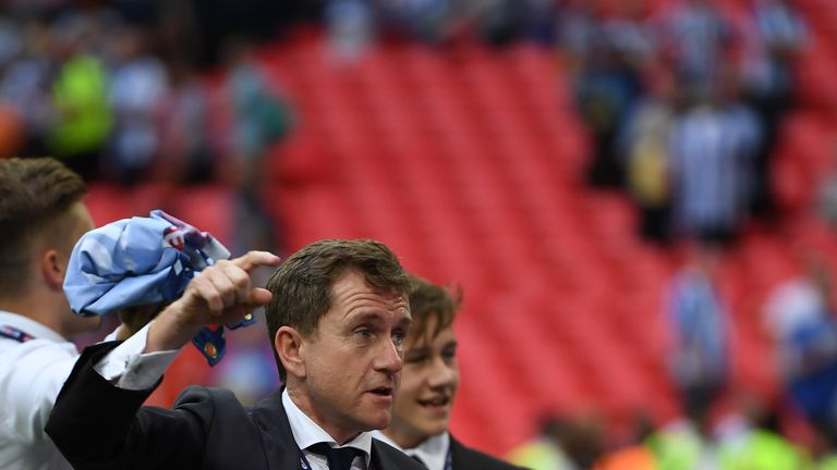 Dean Hoyle chairman of Huddersield Town celebrates