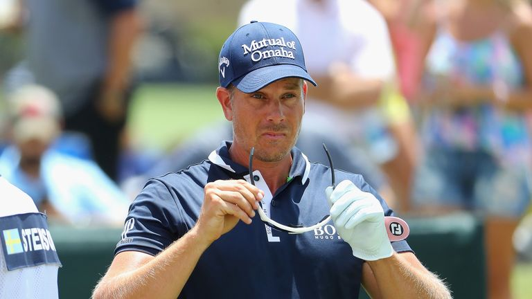 Henrik Stenson of Sweden prepares to play his shot from the third tee during the final round of THE PLAYERS Championship