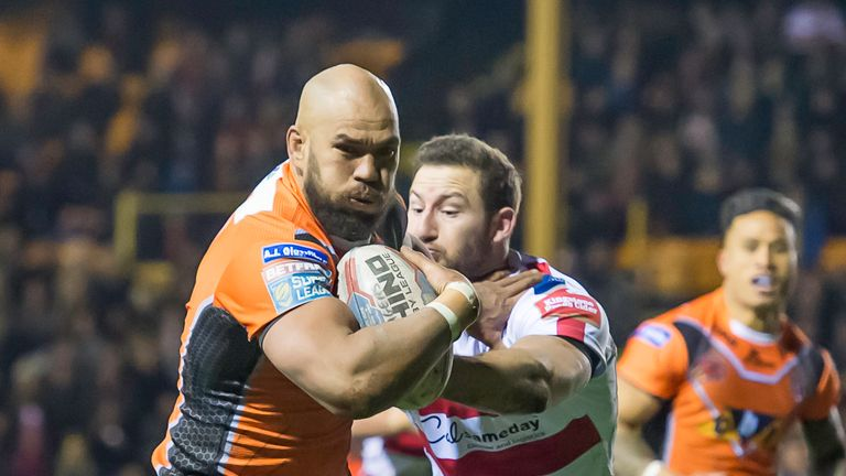 10/02/2017 - Castleford Tigers v Leigh Centurions - The Mend A Hose Jungle, Castleford - Castleford's Jake Webster fends off Leigh's Mitch Brown.