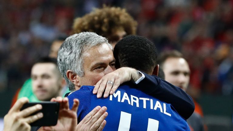 Manchester United's Portuguese manager Jose Mourinho celebrates French striker Anthony Martial after the UEFA Europa League final football match Ajax Amste
