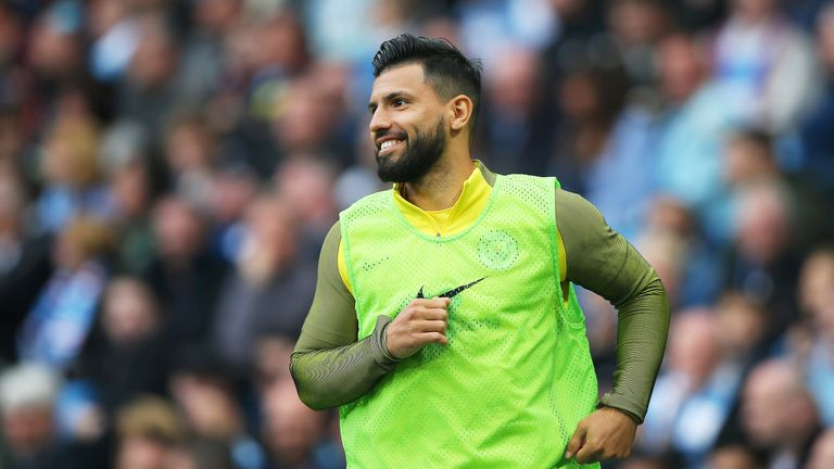 Sergio Aguero warms up on the sidelines during the match against Leicester City