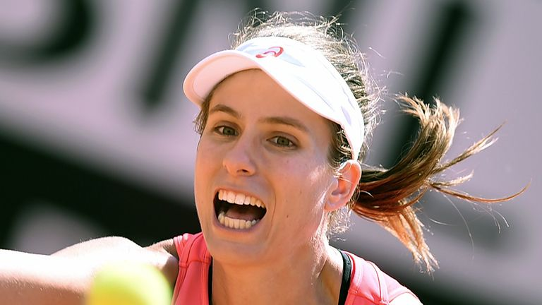 Britain's Johanna Konta eyes the ball during her match against US's Venus Williams at the WTA Tennis Open tournament