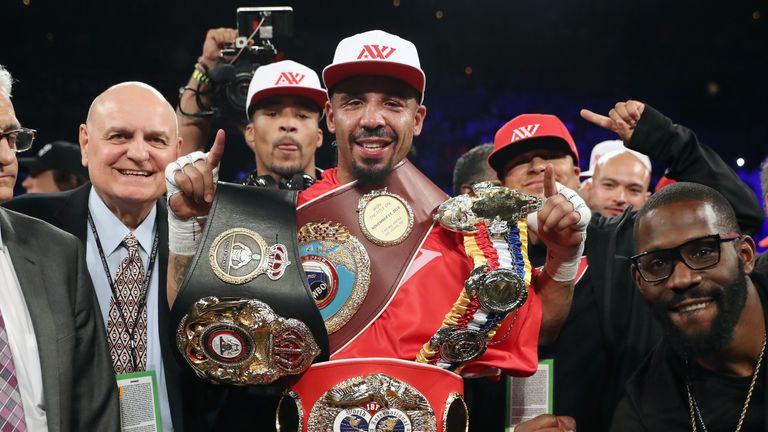 Ward celebrates with world titles after extending his unbeaten record