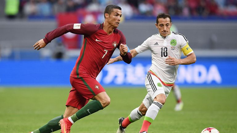 Portugal forward Cristiano Ronaldo (left) battles with Mexico's midfielder Andres Guardado
