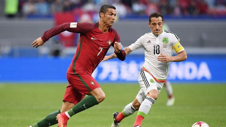 Portugal forward Cristiano Ronaldo (left) battles with Mexico's midfielder Andres Guardado